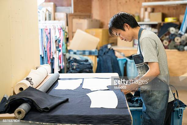 Young tailor working in his design studio