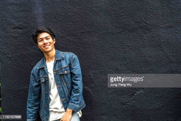 young taiwanese entrepreneur standing in front of his coffee shop - beautiful people stock pictures, royalty-free photos & images