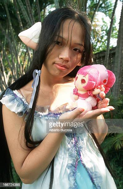 A young Taiwanese girl dressed in a selfmade costume in the occasion of a periodical 'Cosplay' show 'Cosplay' or 'Costume Play' is a Japanese...