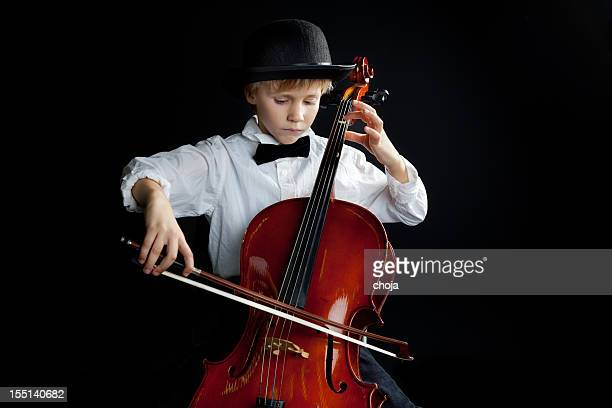 young talented boy with bowler hat playing cello - musical instrument string stock pictures, royalty-free photos & images