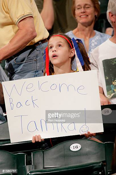 A young Tamika Catchings fans shows her support as Catchings played for the first time this season against the San Antonio Silver Stars at Conseco...