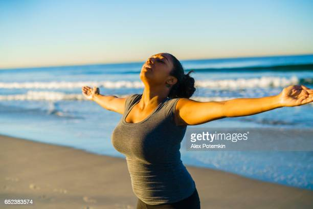 young tanned mixed-race girl practicing fitness on the beach - alex potemkin or krakozawr latino fitness stock photos and pictures