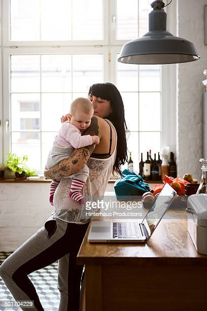 Young Tattoed Mother With Newborn Baby