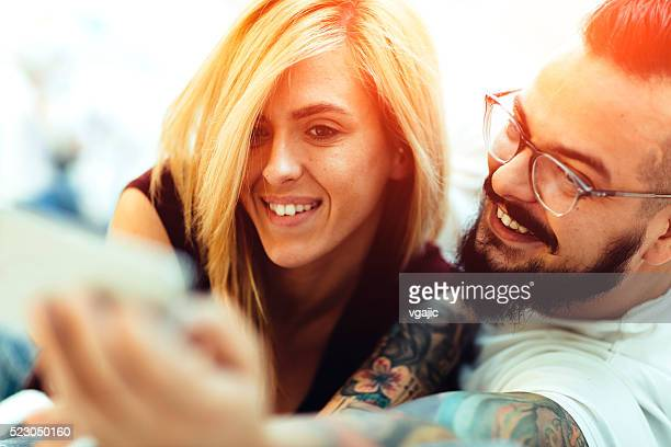 Young Tattooed Couple Making Selfie