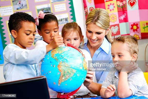 young teacher explaining the world to preschoolers - physical geography stock pictures, royalty-free photos & images