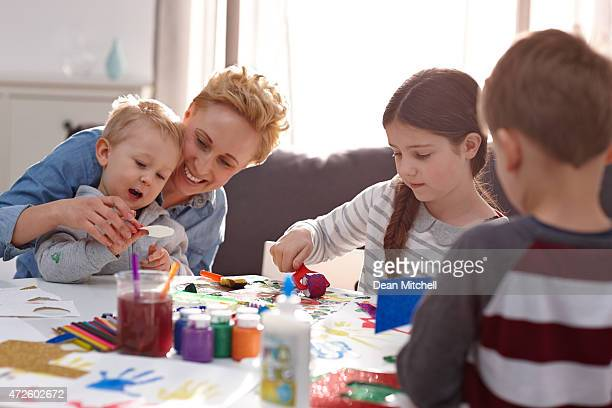 young teacher with preschoolers in art class - art and craft stock pictures, royalty-free photos & images