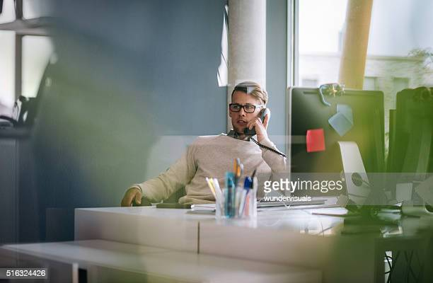 Young team member talking to client on phone