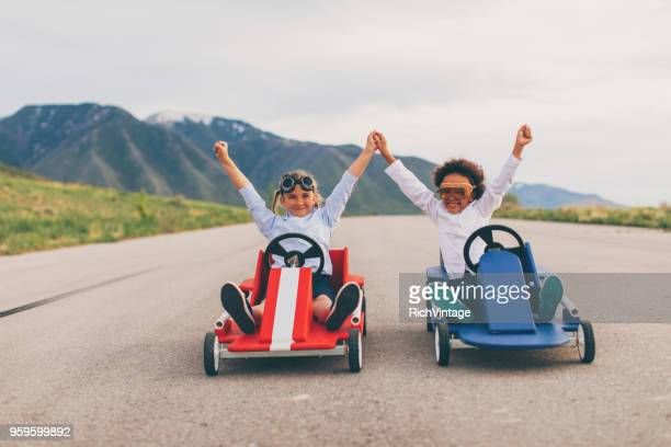 young team of business girls race go carts - colleague stock pictures, royalty-free photos & images