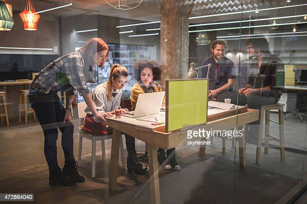 young team of creative people working in office. - nieuw bedrijf stockfoto's en -beelden