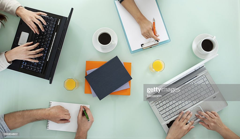 Young team working on laptop computers and writing : Stock Photo