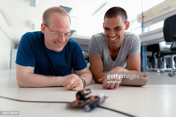 young technicians smiling - mechatronics stock pictures, royalty-free photos & images