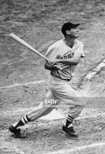 Young Ted Williams drives a ball into the outfield during a game at Fenway Park in Boston in 1955