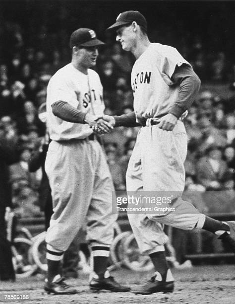 Young Ted Williams is congratulated by Boston Red Sox second baseman Bobby Doerr after a hitting a home run during a game at Fenway Park in Boston in...