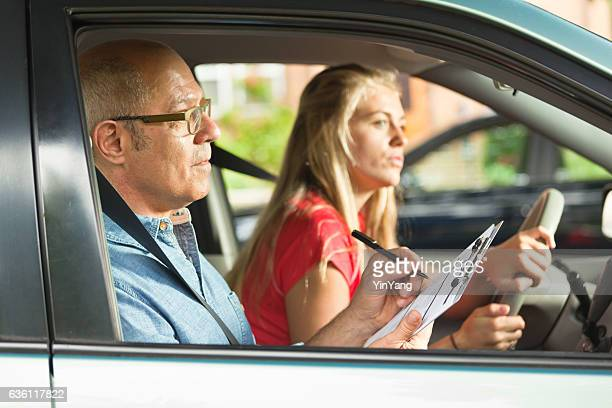 Young Teen Girl Doing Driving Exam with Examiner