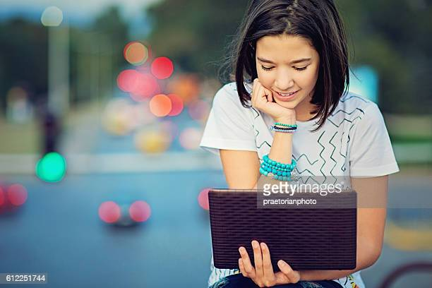 Young teen girl is browsing in the Internet
