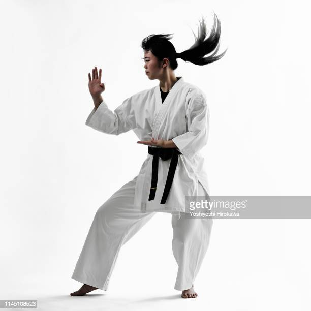 young teen japanese woman doing karate - デイフェンス ストックフォトと画像