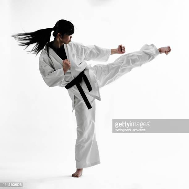 young teen japanese woman doing karate - teenage girls feet stock-fotos und bilder