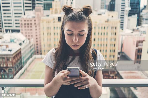 Young Teen using smartphone
