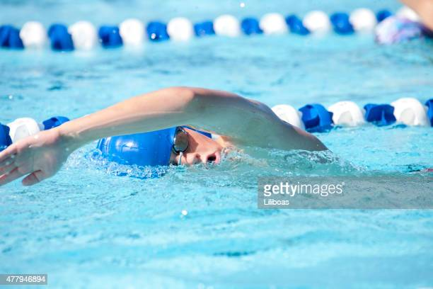 young teenage boy swimming freestyle swim stroke - metre unit of length stock pictures, royalty-free photos & images