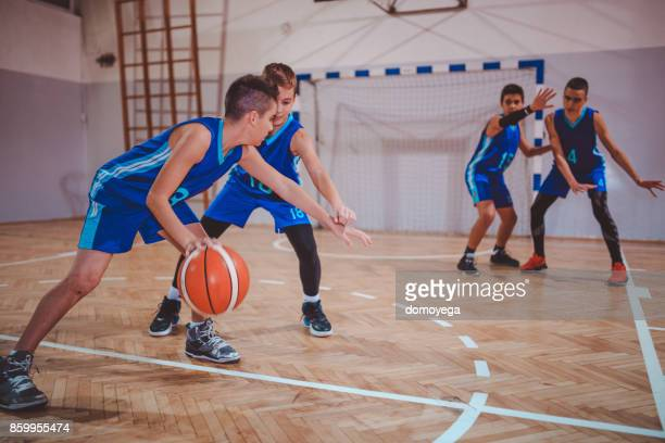 young teenage boys playing basketball - sporting term stock pictures, royalty-free photos & images
