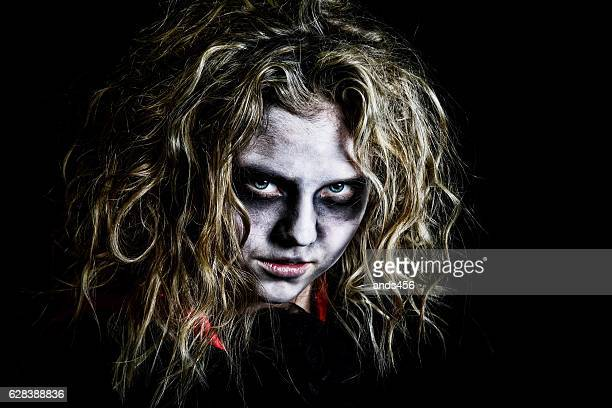 young teenage girl dressed as zombie - zombie makeup stock photos and pictures