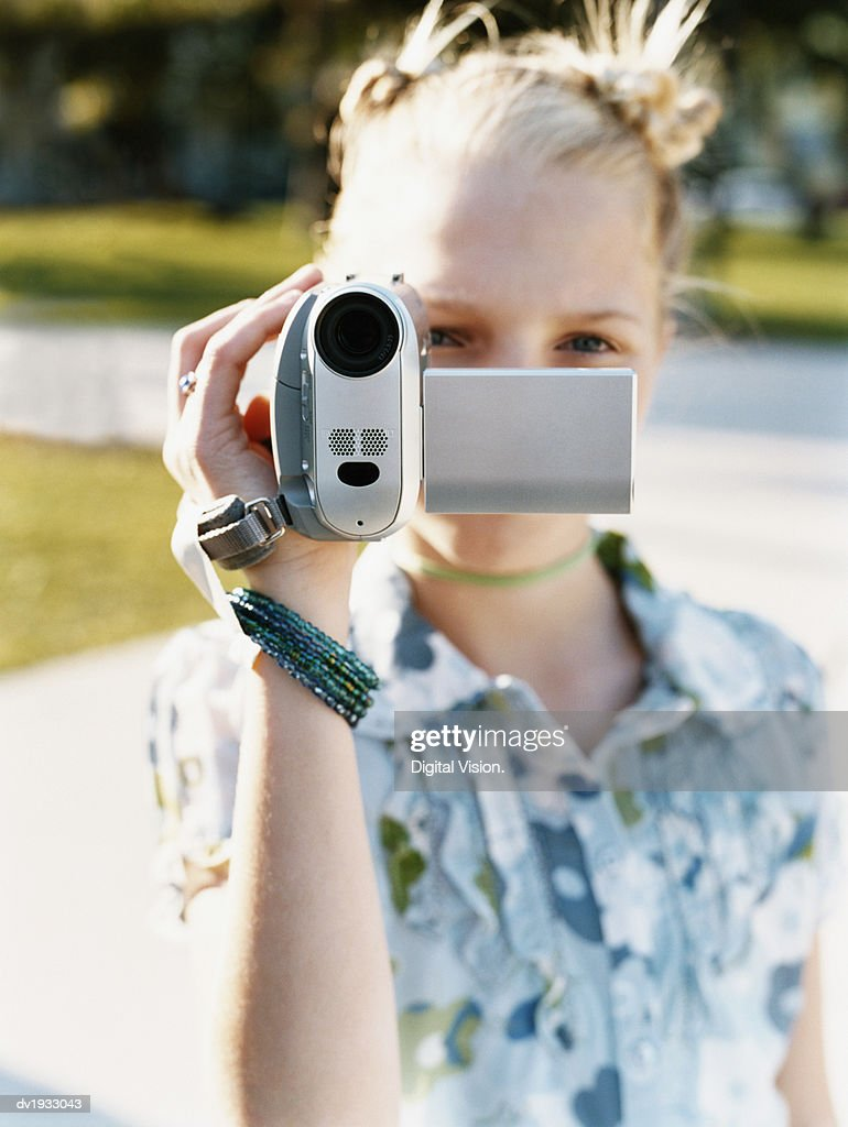 Young Teenage Girl Filming on a Digital Camcorder : Stock Photo
