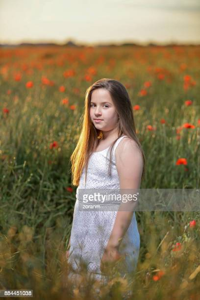 Young teenage girl in wildflowers fied