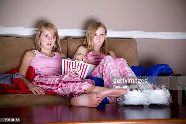Young Teenage Girls Watching a Television