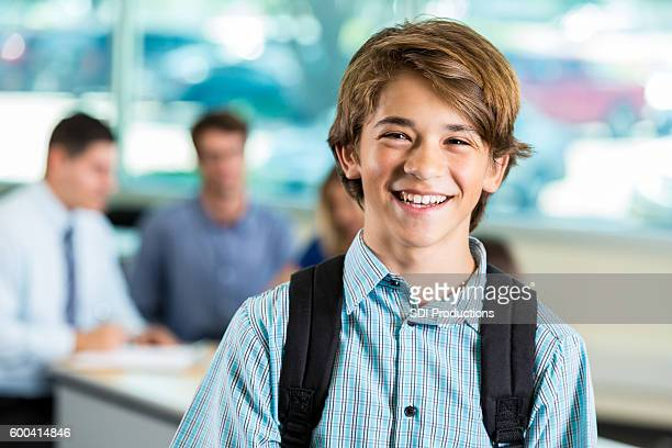 young teenage male student smiling during parent teacher conference - schoolboy stock pictures, royalty-free photos & images