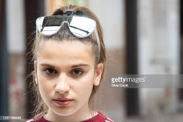 young teenager girl posing on a urban setting serious look - silvia casali stock pictures, royalty-free photos & images