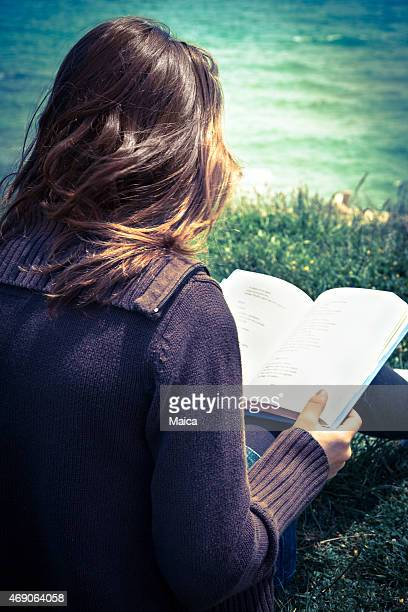 Young teenager girl reading poetry