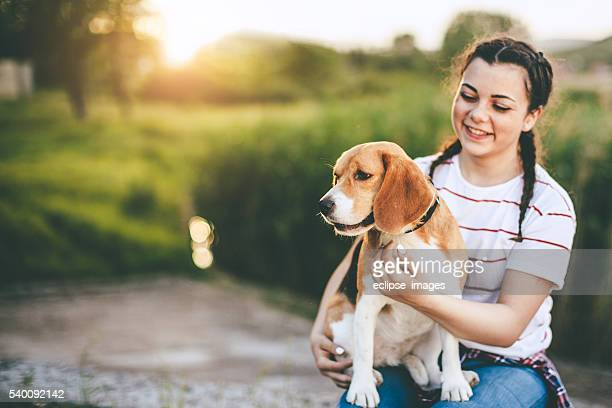 young teenager girl with her best friend the dog