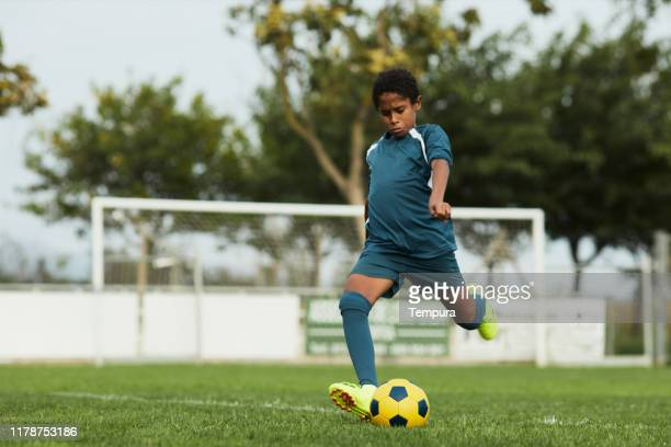 a young teenager is doing a free kick during a youth league game. - the championship football league stock pictures, royalty-free photos & images