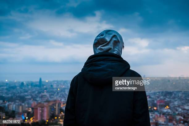 Young teenager watching city views