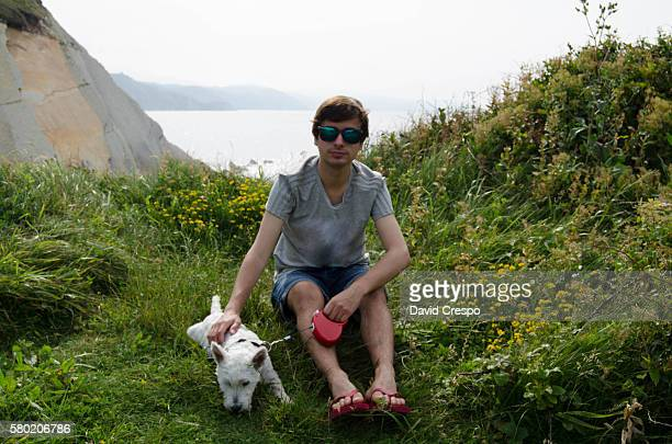 Young teenager with his dog (horizontal)