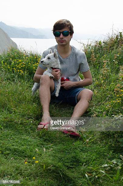 Young teenager with his dog (vertical)