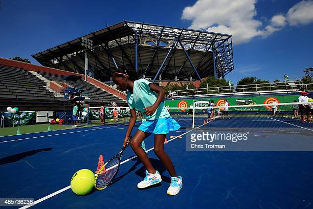 A young tennis fan takes part in Arthur Ashe Kids' Day at the USTA Billie Jean King National Tennis Center on August 29 2015 in New York City