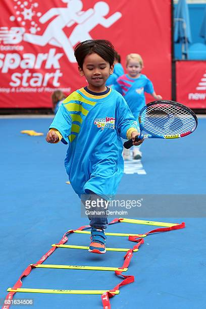 Young tennis fans take part in drills on court during Kids Tennis Day ahead of the 2017 Australian Open at Melbourne Park on January 14 2017 in...