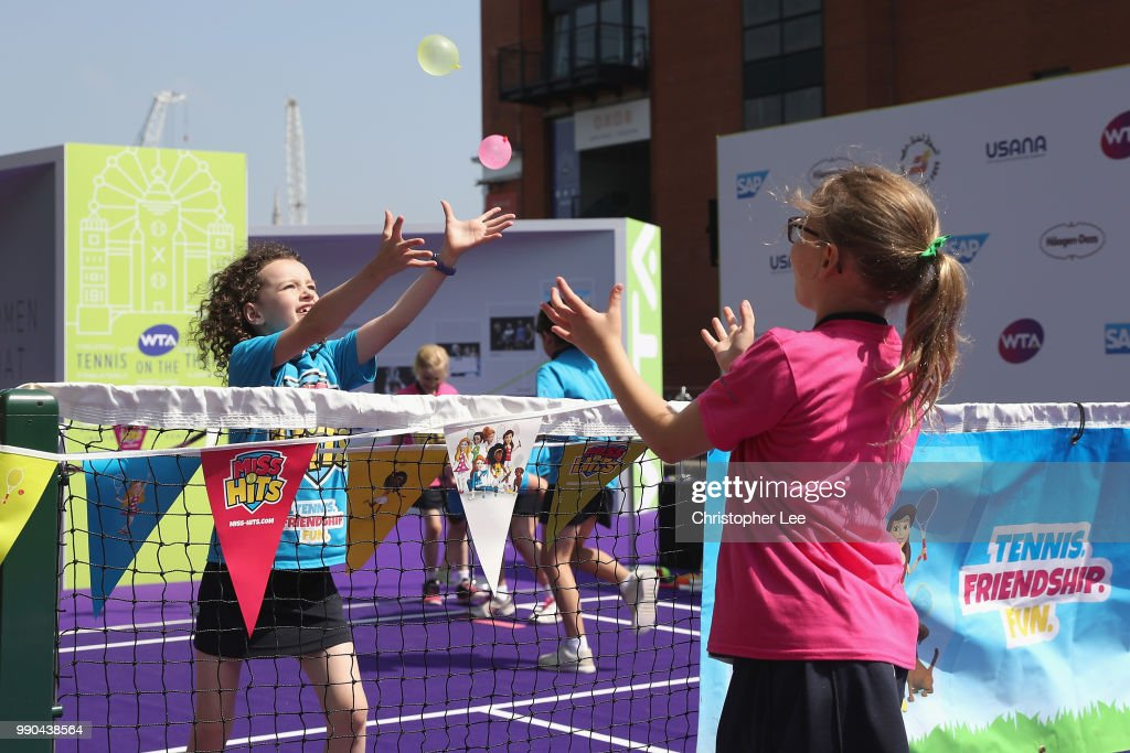 Young tennis fans take part in the Miss Hits lessons during the WTA Tennis On The Thames in Bernie Spain Gardens on June 28, 2018 in London, England.