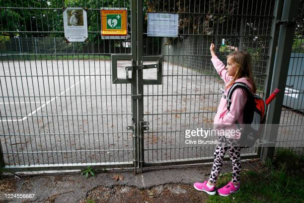 Young tennis player Saskia Brunskill, daughter of the photographer finds that the tennis courts at John Leigh Park in Altrincham are locked, Saskia...