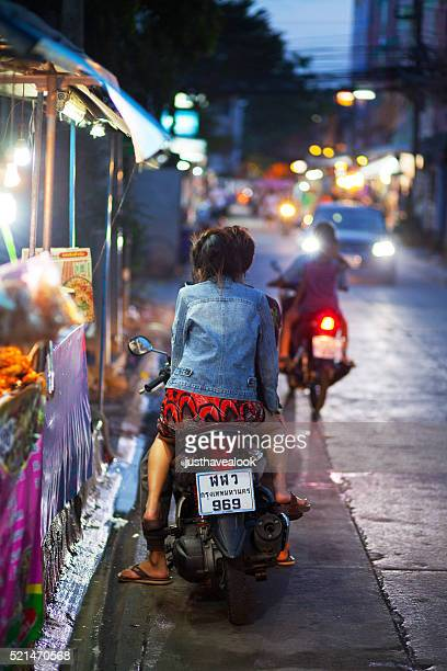 Young thai couple on motorcycle