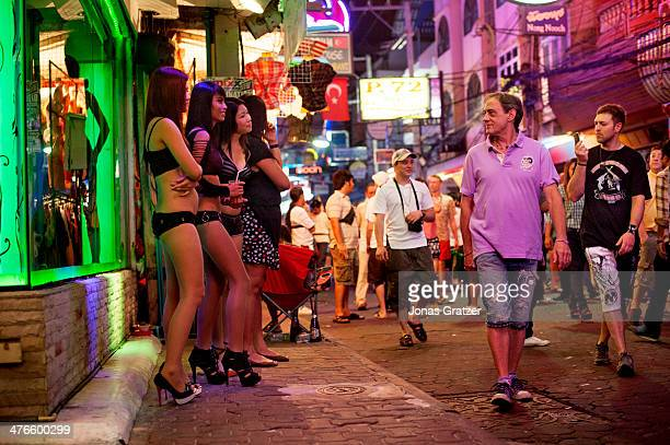 Young Thai girls in bikinis and cosplay uniforms stand outside the brothels of Pattaya city to lure in tourists and customers With its reputation as...