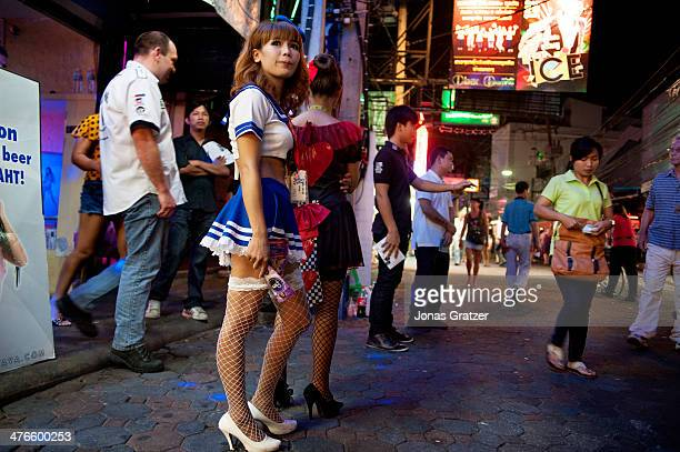 Young Thai girls in cosplay uniforms stand outside the brothels of Pattaya city to lure in tourists and customers With its reputation as one of the...