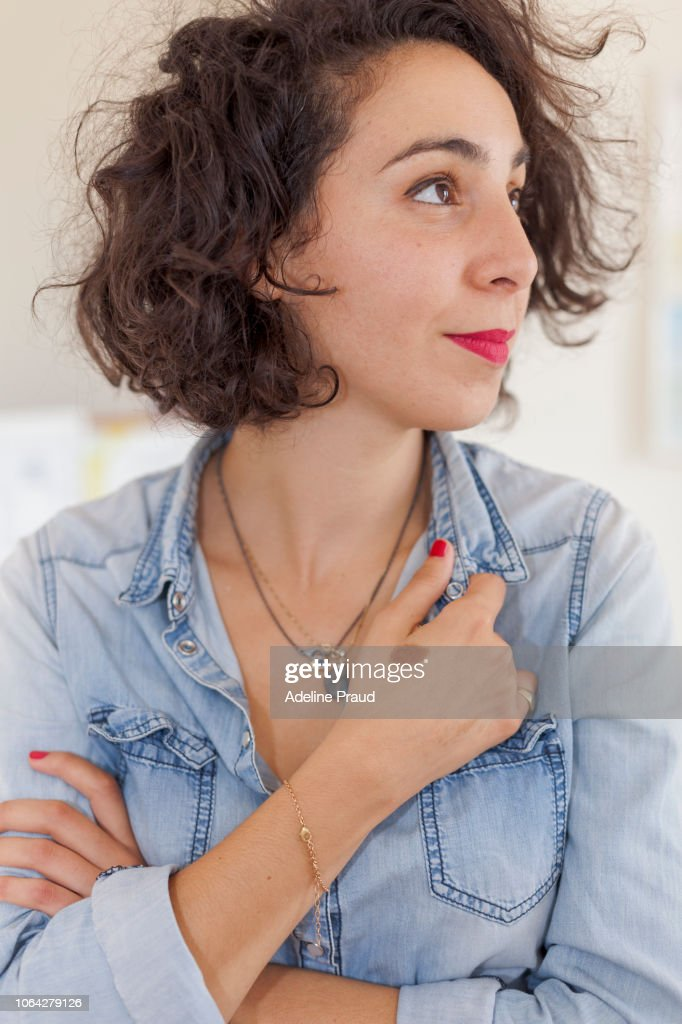 Young therapist working in her cabinet : Stock Photo