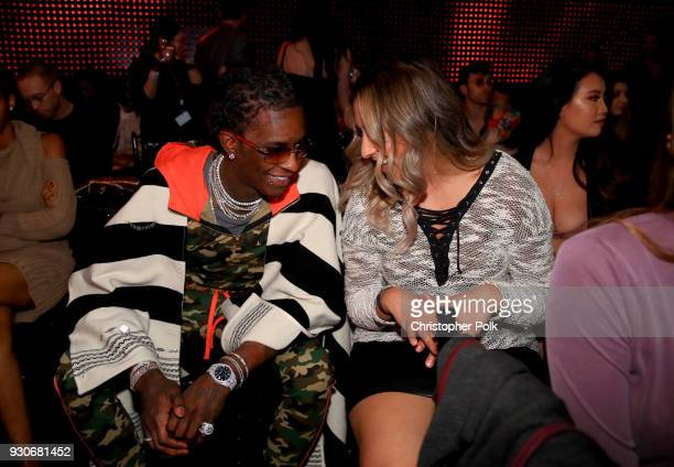 Young Thug and guest attend the 2018 iHeartRadio Music Awards which broadcasted live on TBS TNT and truTV at The Forum on March 11 2018 in Inglewood...