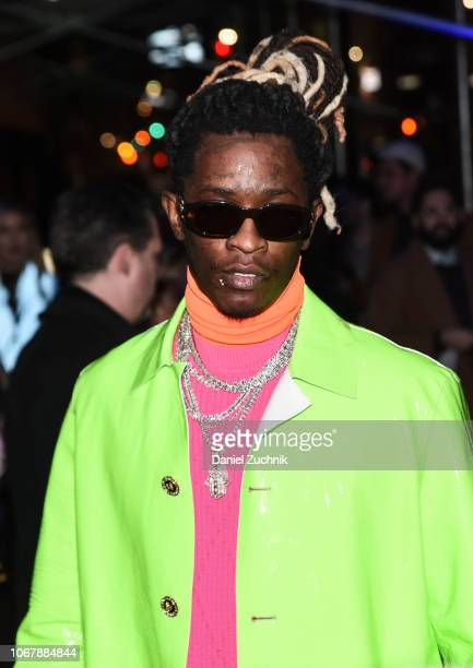 Young Thug is seen wearing a bright green coat outside the Versace PreFall 2019 Collection on December 2 2018 in New York City