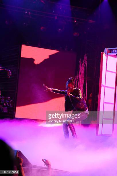 Young Thug poses on stage during the 2016 BET Hip Hop Awards at Cobb Energy Performing Arts Center on September 17 2016 in Atlanta Georgia