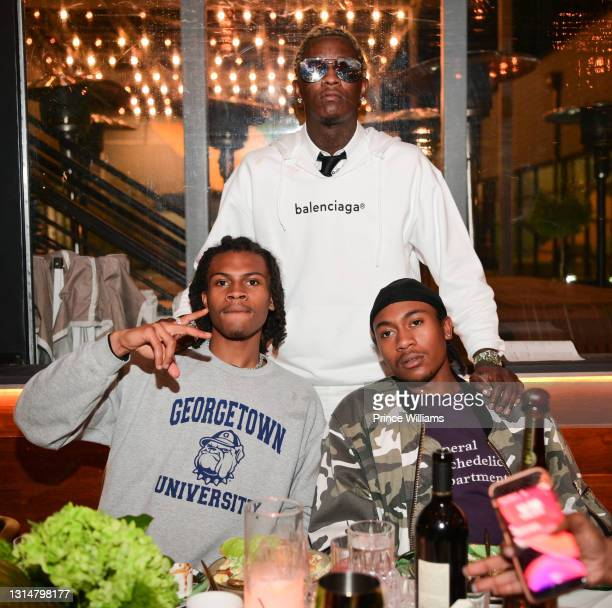 Young Thug, Yung Kayo and Daniel Green attend Slime Language 2 Album Event at Annette's Chop House on April 26, 2021 in Atlanta, Georgia.