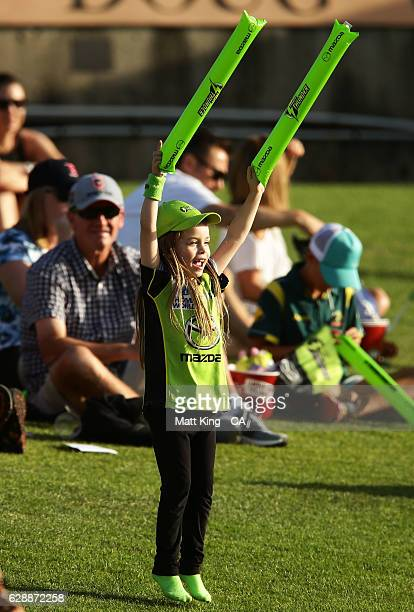 'SYDNEY AUSTRALIA DECEMBER 10 A young Thunder fan suppports during the Women's Big Bash League match between the Sydney Thunder and the Melbourne...