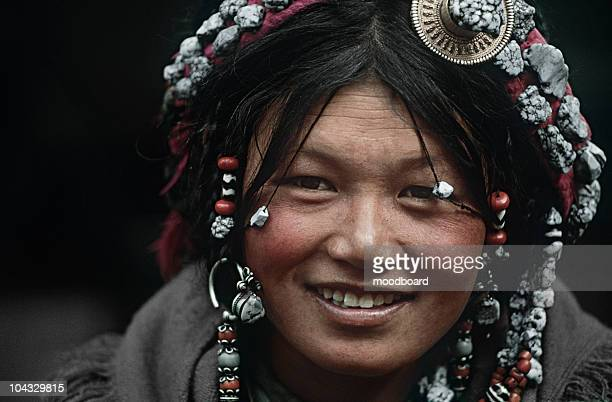 Young Tibetan Woman Wearing Traditional Hair Accessories